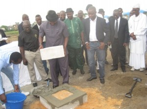 Sir, Patrick Ferife, representing Governor Emmanuel Uduaghan laying the foundation stone of the Delta City Mall, Effurun, Delta State, while others look on