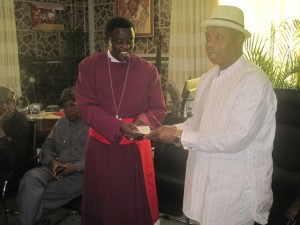 Delta State Flood Management Committee Chairman, Justice Francis Tabai (right) presenting the Cheques to Arch Bishop Goddowel Awomakpa, Chairman CAN, South/South.