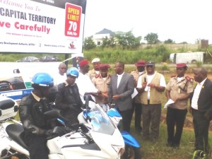 The community Engagement Co-ordinator of Chevron Nigeria Limited, Mr. Charles Egbuedo, handing over the keys of the Police Motor Bikes to Chief Clement Ofuani.