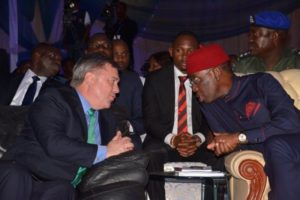 Chairman/MD CNL (L) and Governor Okowa in a chat during the Summit.