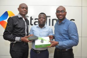 L-R: John Oseimeme, Sales Director, Israel Bolaji, Head of Public Relations and Dare Kafar, Marketing Director, all of StarTimes Nigeria unveiling the New StarTimes 2-in-1 Combo Decoder in Lagos.