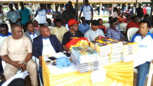 Surveyor Peter Akarogbe (2nd left) Dr Mrs Veronica Ogbuagu (middle) and others during  the donation of free text books to Schools in Oyede community yesterday.