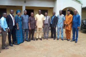 Mr Patrick Ukah, Delta State Commissioner for information (middle), Comrade Michael Ikeogwu, Delta State NUJ Chairman (5th Left) and his executive members in a group photograph during the courtesy call to Commissioner.