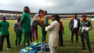Rt Hon Sheriff Oborevwore, Speaker Delta State House of Assembly, handing presenting a bouquet to one of the winners.