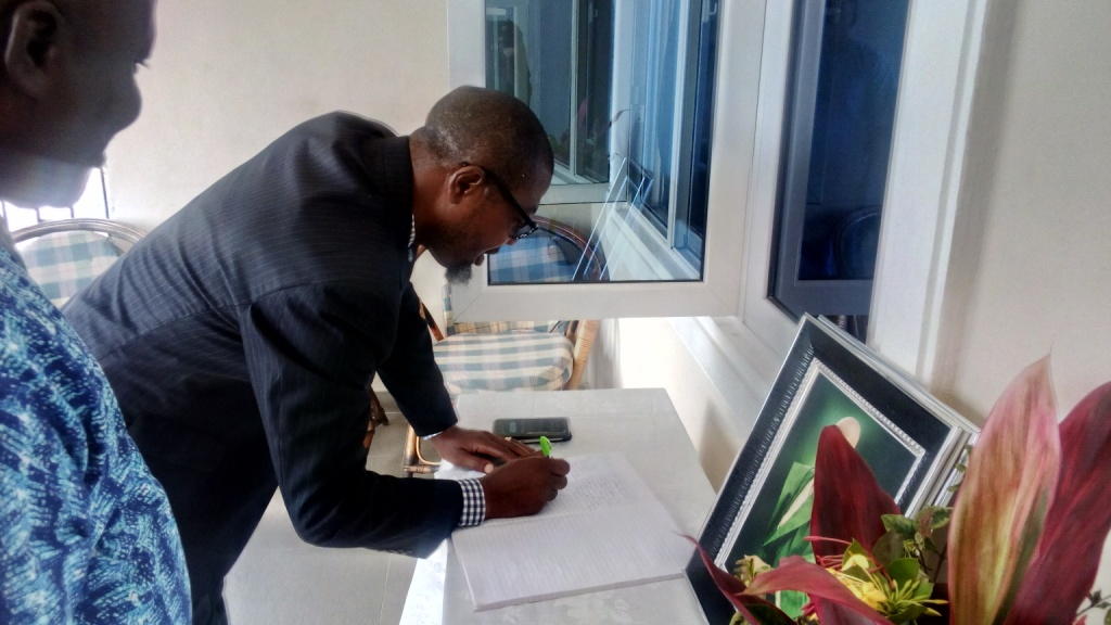 ESV Efe Appih, Chairman, NIESV, Delta State chapter, signing the condolence register when the paid the family of late ESV Ben Apkoriaye's family a condolence visit in Warri, yesterday.